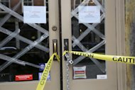 In this Thursday, Feb. 7, 2013 photo, caution tape and signs warn that Barbarini restaurant on Front St. in New York has no flooring. Nearly four months after Superstorm Sandy hit, the historic cobblestone streets near the water&#39;s edge in lower Manhattan are eerily deserted, and among local business owners, there is a pervasive sense that their plight has been ignored by the rest of Manhattan. (AP Photo/Mary Altaffer)
