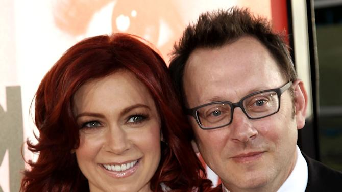 "FILE - This May 30, 2012 file photo shows married actors Carrie Preston, left, and Michael Emerson at the premiere of HBO's ""True Blood"" in Los Angeles.  Emerson has played a serial killer, a mysterious, villainous Island leader and currently stars as a billionaire computer genius on ""Person of Interest."" But he says playing the romantic interest for his real life wife has been his most unsettling role. Emerson plays the off-beat Harold Finch in ""Person of Interest,"" which airs Thursdays at 10 p.m. Eastern. His wife Carrie Preston has a recurring role as Finch's former fiance, who believes he is dead. (Photo by Matt Sayles/Invision/AP, file)"