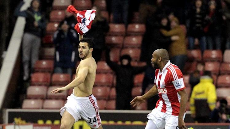 Stoke City's Oussama Assaidi (left) celebrates his late goal during the English Premier League match against Chelsea at the Britannia Stadium in Stoke on Trent, on December 7, 2013