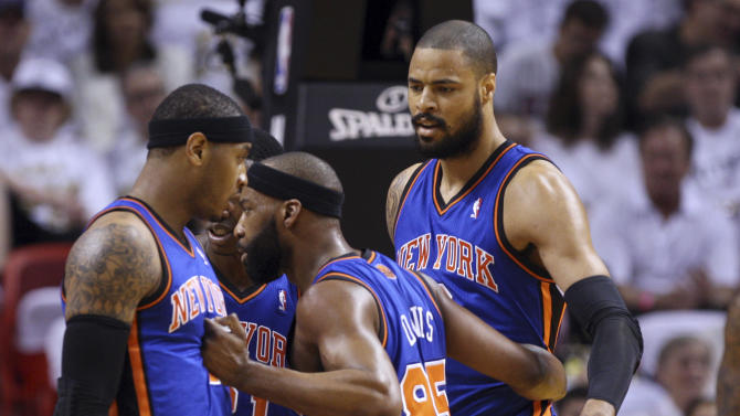 New York Knicks' Baron Davis (85) talks with Carmelo Anthony, left, and Tyson Chandler, right, in the first half during an NBA basketball game against the Miami Heat in the first round of the Eastern Conference playoffs in Miami, Saturday, April 28, 2012. (AP Photo/Lynne Sladky)
