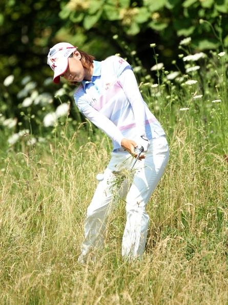 Na Yeon Choi of South Korea hits her third shot on the par 4 12th hole during the final round the 2012 U.S. Women's Open at Blackwolf Run on July 8, 2012 in Kohler, Wisconsin. (Photo by Andy Lyons/Getty Images)