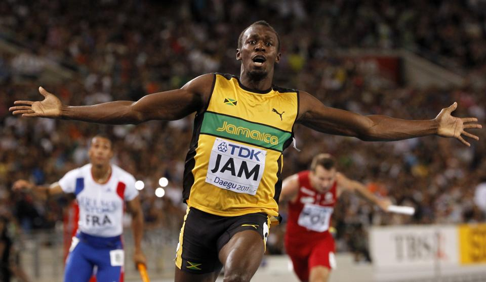 Jamaica's Usain Bolt celebrates winning the Men's 4x100 Relay final and setting a world record at the World Athletics Championships in Daegu, South Korea, Sunday, Sept. 4, 2011. (AP Photo/Anja Niedringhaus)