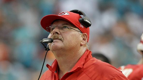 Kansas City Chiefs head coach Andy Reid watches a replay of a safety play during the second half of an NFL football game against the Miami Dolphins, Sunday, Sept. 21, 2014, in Miami Gardens, Fla