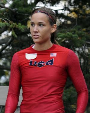 FILE - Olympic hurdler Lolo Jones waits for her run at the U.S. women's bobsled push championships on in this Oct. 5, 2012 file photo taken in Lake Placid, N.Y. The U.S. Bobsled and Skeleton Federation said Tuesday night July 16, 2013 it has found no reason to sanction Olympic hopeful Lolo Jones for her involvement in a nightclub altercation Saturday that involved the stepdaughter of one of the sport's Hall of Famers. (AP Photo/Michael Lynch, File)