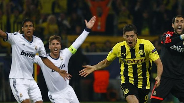 Borussia Dortmund's Robert Lewandowski celebrates after scoring a goal as Real Madrid's Raphael Varane (L) Sergio Ramos (2nd L) and goalkeeper Diego Lopez (R) appeal for offside, during their Champions League semi-final first leg. (Reuters)