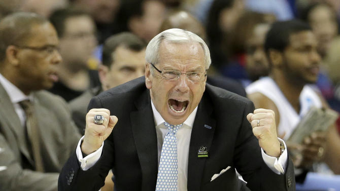North Carolina coach Roy Williams cheers on his team during the second half of a second-round game against Villanova in the NCAA college basketball tournament Friday, March 22, 2013, in Kansas City, Mo. (AP Photo/Charlie Riedel)