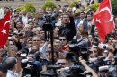 A man shouts as Turkey&#039;s President Abdullah Gul talks to people during his visit to one of the two blast sites in the town of Reyhanli