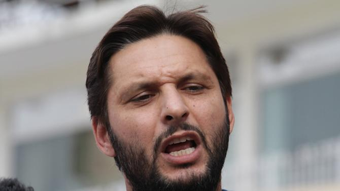FILE - In this Friday, May 23, 2014 file photo, Pakistan's cricket all-rounder Shahid Afridi talks to reporters in Lahore, Pakistan. The Pakistan Cricket Board on Tuesday, Sept. 16, 2014 has named Afridi as captain of Twenty20 team until 2016 while Misbah-ul-Haq is retained as skipper for World Cup next year. (AP Photo/K.M. Chaudary, File)