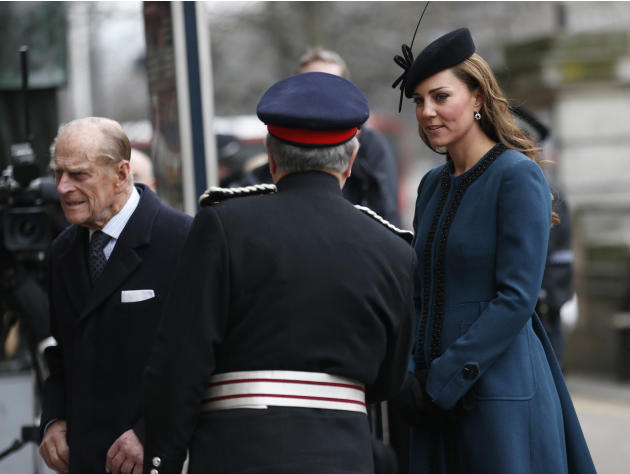 Britain's Kate, Duchess of Cambridge, right, accompanies Queen Elizabeth II, unseen, and Prince Philip, left, at Baker Street underground station in London for a visit to mark the 150th anniversary of