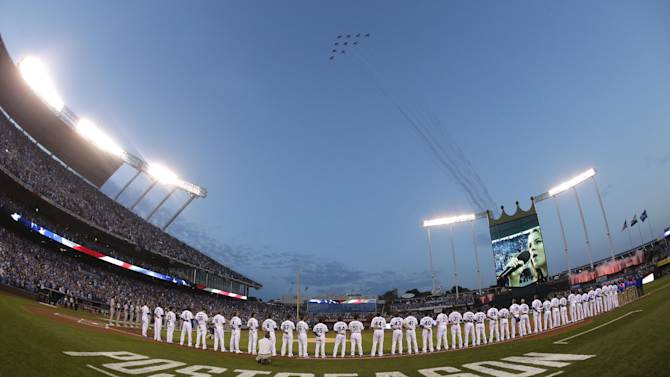 In this image taken with a fisheye lens, players stand for the national anthem before the AL wild-card playoff baseball game between the Kansas City Royals and the Oakland Athletics on Tuesday, Sept. 30, 2014, in Kansas City, Mo. (AP Photo/Charlie Riedel)