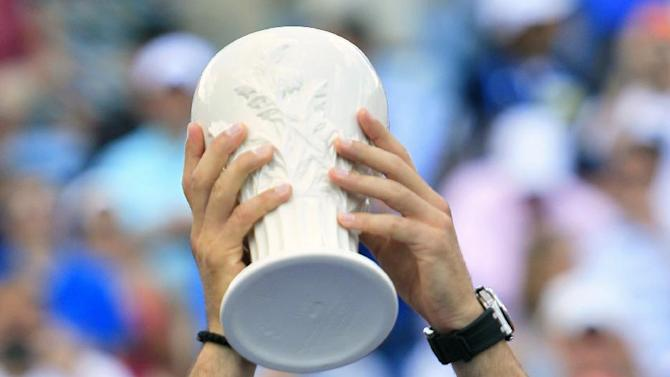 Novak Djokovic, from Serbia, holds the runner-up trophy after losing to Roger Federer, from Switzerland, 6-0, 7-6 (7) in the men's final at the Western & Southern Open tennis tournament, Sunday, Aug. 19, 2012, in Mason, Ohio. (AP Photo/Al Behrman)