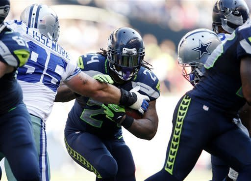 Lynch rumbles, Seattle stymies Romo, Dallas 27-7