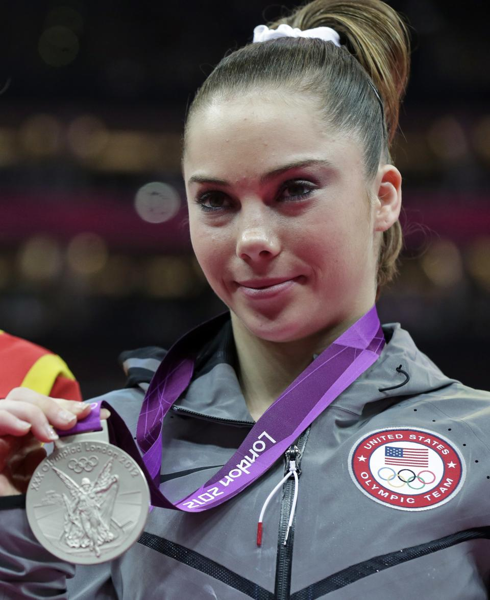 U.S. gymnast McKayla Maroney displays her silver medal during the podium ceremony for the artistic gymnastics women's vault finals at the 2012 Summer Olympics, Sunday, Aug. 5, 2012, in London. (AP Photo/Julie Jacobson)