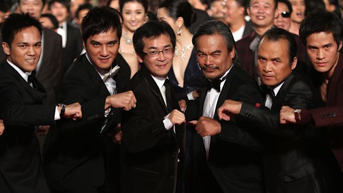 """Taiwanese director Wei Te-sheng, third from left, and Taiwanese actors of the movie """"Warriors of the Rainbow: Seediq Bale"""" Bokeh Kosang, first left, and Lin Ching-tai, forth left, pose with other actors at the 48th Golden Horse Awards, Saturday, Nov. 26, 2011, in Hsinchu, northern Taiwan. Wei is nominated for Best Director of the film """" Warriors of the Rainbow: Seediq Bale """" at this year's Golden Horse Awards -one of the Chinese-language film industry's biggest annual events. (AP Photo/Chiang Ying-ying)"""