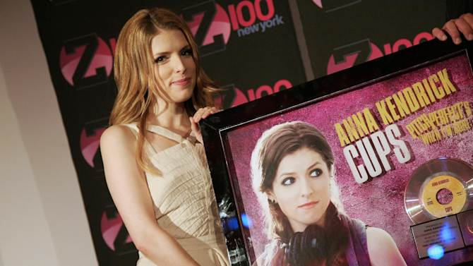 "FILE - This June 7, 2013 file photo shows actress Anna Kendrick at an appearance at the iHeartRadio Theater in New York. Since its release in Sept. 2012, ""Pitch Perfect: Original Motion Picture Soundtrack"" has peaked at No. 3 on Billboard's 200 albums chart and has sold more than 700,000 units, according to Nielsen SoundScan. Kendrick's ""Cup"" is certified platinum and is a Top 30 hit on the Billboard Hot 100 chart. (Photo by Andy Kropa/Invision/AP, file)"