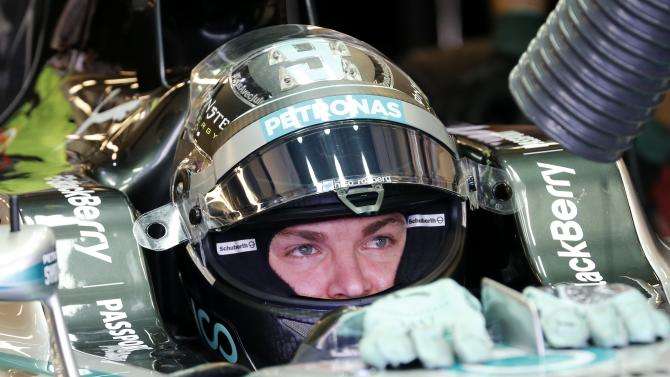 Mercedes Formula One driver Nico Rosberg of Germany sits in the car after a run during the third practice session of the Abu Dhabi F1 Grand Prix at the Yas Marina circuit in Abu Dhabi