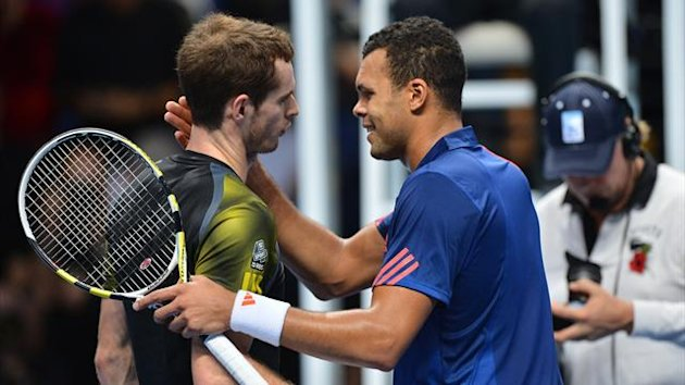 Andy Murray (L) shakes hands with Jo-Wilfried Tsonga (R) after winning their group A singles match against in the round robin stage on the fifth day of the ATP World Tour Finals (AFP)