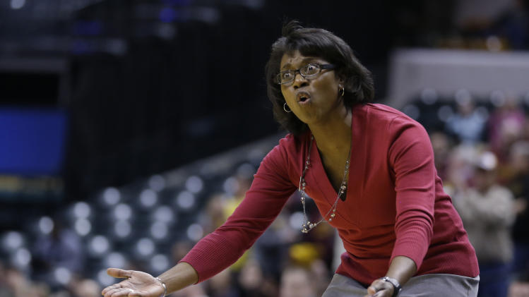 Wisconsin head coach Bobbie Kelsey questions the lack of a call in the second half of an NCAA college basketball game against Minnesota in the opening round of the Big Ten Tournament in Indianapolis, Ind., Thursday, March 6, 2014. Minnesota defeated Wisconsin 74-68 in overtime. (AP Photo/Michael Conroy)