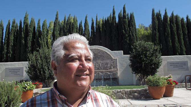 In this photo taken Tuesday Oct. 2, 2012, Paul Chavez, Cesar Chavez's middle son and president of the Cesar Chavez Foundation stands near his father's grave site in the memorial garden in Keene, Calif. Today, the foothills of the Tehachapi mountains continue to house the United Farm Workers of America headquarters and memorials to Chavez, though farmworkers no longer live there. President Obama is designating parts of the property as a national monument and visiting the site on Monday, a move seen as likely to shore up support from Hispanic and progressive voters just five weeks before the election.   (AP Photo/Gosia Wozniacka)