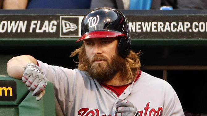 In this May 22, 2014, file photo, Washington Nationals' Jayson Werth waits on the dugout steps to bat during the first inning of a baseball game against the Pittsburgh Pirates in Pittsburgh. Werth pleaded guilty Thursday, Jan. 28, 2014, to reckless driving and has been sentenced to five days in jail for driving 105 mph on the Capital Beltway. Werth was convicted last month in Fairfax County and sentenced to 10 days in jail, but appealed his conviction to Circuit Court. It is not unusual in Virginia for judges to impose short jail sentences in cases where speeds exceed 100 mph. He will serve his sentence on weekends to minimize disruption to his rehabilitation following shoulder surgery