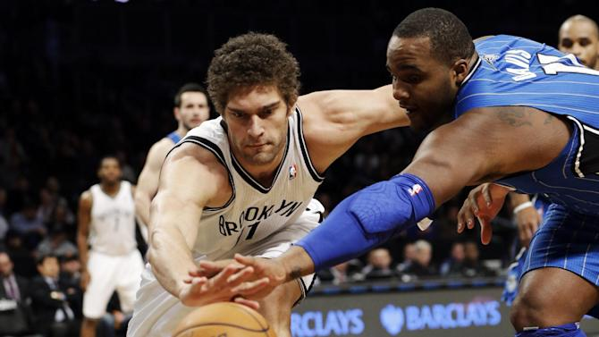 Brooklyn Nets center Brook Lopez (11) and Orlando Magic forward Glen Davis (11) go after a loose ball in the first half of their NBA basketball game at Barclays Center, Monday, Jan. 28, 2013, in New York. (AP Photo/Kathy Willens)