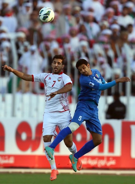 Ali al-Ahajiri (L) of United Arab Emirates vies for the ball against Mohammad Sanad of Kuwait during the two teams' semi-final match in the 21st Gulf Cup in Manama, on January 15, 2013. AFP PHOTO/MARW