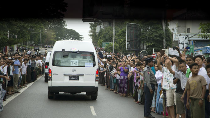 People line the street to see U.S. President Barack Obama travel in his motorcade to meet with Myanmar's President Thein Sein at the Yangon Parliament building in Yangon, Myanmar, Monday, Nov. 19, 2012. This is the first visit to Myanmar by a sitting U.S. president. (AP Photo/Carolyn Kaster)