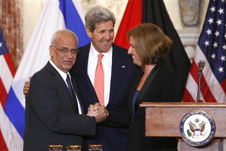 Chief Palestinian negotiator Erekat, U.S. Secretary of State Kerry and Israel's Justice Minister Livni shake hands at a news conference at the end of talks at the State Department in Washington
