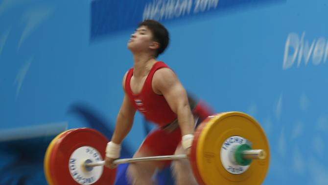 Sirikaew competes in the women's 63kg snatch weightlifting competition during the 17th Asian Games in Incheon