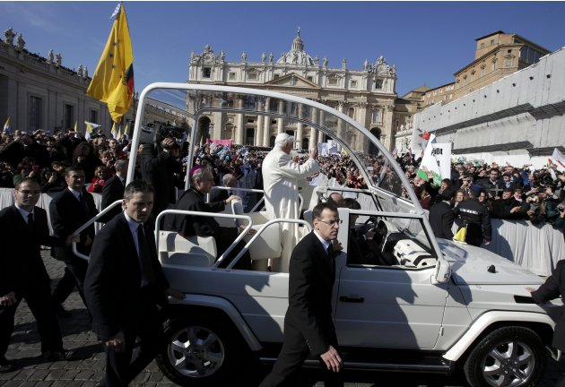 Pope Benedict XVI rides around St Peter's Square to hold his last general audience at the Vatican