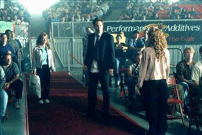 "Agent Mulder (David Duchovny, center) confronts feuding sisters Betty Templeton and Lulu Pfeiffer (both played by Kathy Griffin, left and right) in the ""Fight Club"" episode of Fox's The X-Files X-Files"
