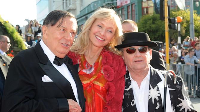 "Cast members Barry Humphries, left, who plays Great Goblin, his wife Lizzie Spender, center, and  Sylvester McCoy who plays Radagast, on the red carpet at the premiere of ""The Hobbit: An Unexpected Journey,""  at the Embassy Theatre, in Wellington, New Zealand, Wednesday, Nov. 28, 2012.  (AP Photo/SNPA, Ross Setford) NEW ZEALAND OUT"