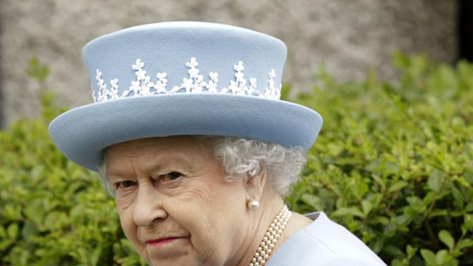 Britain's Queen Elizabeth II arrives for a Service of Thanksgiving in Saint Macartin's Cathedral in Enniskillen, Northern Ireland, Tuesday, June 26, 2012.  The Queen and the Duke of Edinburgh arrived in Northern Ireland for a two day visit to mark the Queen's Diamond Jubilee. (AP Photo/Peter Morrison)