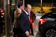 French President Francois Hollande leaves the headquarters of French TV channel TF1 in Boulogne-Billancourt, a Paris suburb. Hollande Sunday pledged 30 billion euros in new taxes and savings to balance the budget and fund a turnaround in two years and rejected criticism of dragging his feet