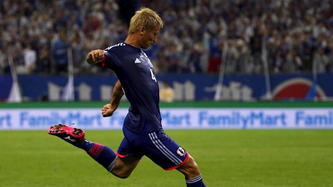 Japan's Honda kicks the ball to score against Cambodia during their 2018 World Cup qualifying soccer match at Saitama