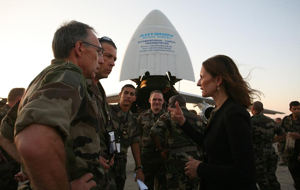 French Military doctors stand in front a cargo plane with the French Ambassador in Amman Corinne Breuze, right,  at Marka airport,  in Amman, Jordan, Saturday, Aug. 11, 2012.  The French military will open a field hospital at a Syrian refugees camp at the Jordanian -Syrian border. (AP photo/Mohammad Hannon)
