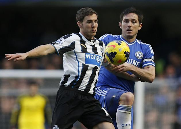 This is a Saturday, Feb. 8, 2014 file photo of Newcastle United's Dan Gosling, left, as he competes with Chelsea's Frank Lampard during their English Premier League soccer match at Stamford Br