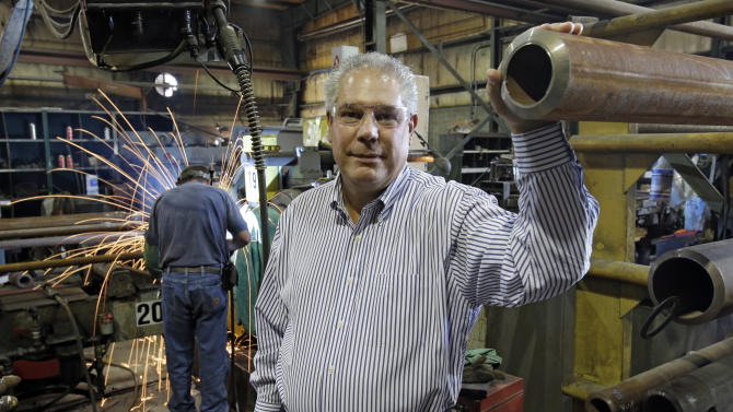 """In this Thursday, Sept. 6, 2012 photo, Joseph Halter, CEO of Solmet Technologies, poses in his factory in Canton, Ohio. Halter, a Republican, was forced to cut workers during the downturn. He watched with frustration as billions of dollars were doled out to stimulus projects, drowning banks, the collapsing U.S. auto industry - and green energy companies. """"I don't know that government spending has ever really grown the economy,"""" he says. """"I don't believe in subsidies - period,"""" Halter adds, pointing out no federal agency provided money when his business struggled. (It has since rebounded and added workers.) He prefers tax cuts and less regulation. (AP Photo/Mark Duncan)"""