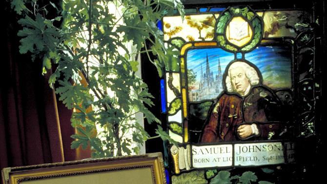 This March 17, 2009 photo released by VisitBritain shows shows a letter written by Samuel Johnson and a copy of the dictionary he wrote, which was published in 1755, beneath a stained glass plaque at Dr. Johnson's House, a small museum in the 300-year-old townhouse where he lived in London. The house is a good destination for visitors on a literary tour of London. (AP Photo/VisitBritain)