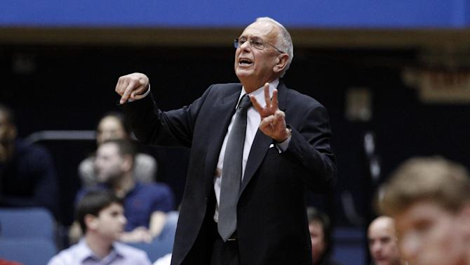 FILE - In a Wednesday, Nov. 28, 2012 file photo, SMU head coach Larry Brown instructs his team during an NCAA college basketball game against Utah, in Dallas. Brown was 71 when he was hired by SMU, and hadn't coached in college since leading Kansas to the 1988 NCAA title, so there were more than a few question marks when he took over the Mustangs. Brown made the transition a seamless one, leading SMU to eight wins in its first nine games while creating excitement that Moody Coliseum hasn't seen in years.(AP Photo/Tony Gutierrez, File)
