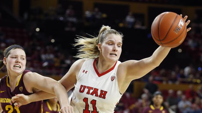 Utah's Taryn Wicijowski (11) beats Arizona State's Sophie Brunner (21) to the ball for a rebound during the first half of an NCAA college basketball game Friday, Feb. 27, 2015, in Tempe, Ariz. (AP Photo/Ross D. Franklin)