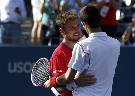 Djokovic of Serbia is congratulated by Wawrinka of Switzerland after Djokovic won their men's semi-final match at the U.S. Open tennis championships in New York