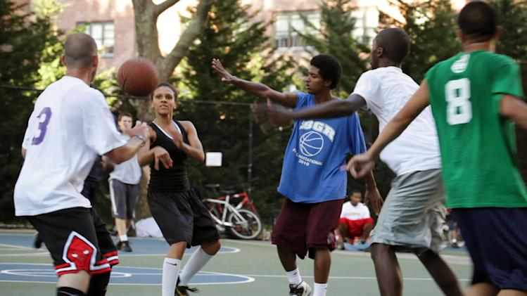 "This film publicity image released by Doin' It In The Park, LLC shows female basketball player Niki Avery, second left, playing basketball in the Spanish Harlem section of New York during filming of the documentary ""Doin' It In The Park."" (AP Photo/Doin' It In The Park, LLC)"