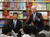 Chinese Vice President Xi Jinping and Vice President Joe Biden take questions from students at the International Studies Learning Center in South Gate, Calif. , Friday, Feb. 17, 2012. (AP Photo/Damian Dovarganes)