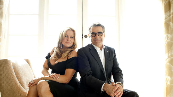 """In this March 18, 2012 photo, actors Jennifer Coolidge, left, and Eugene Levy pose for a portrait during a media day for the upcoming feature film """"American Reunion"""" in Los Angeles. The film opens nationwide on Friday, April 6. (AP Photo/Dan Steinberg)"""