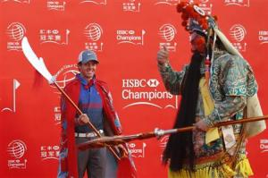 Golfer Rory McIlroy of Northern Ireland attends a photo call for the WGC-HSBC Champions golf tournament on the Bund in Shanghai