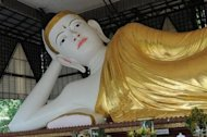Buddha at a pagoda in Myitkyina, in Kachin province in May 2012. Timber, jade and gold from the province are being used to develop lower Myanmar, say locals as mediators seek to end fighting between Myanmar's army and ethnic minority rebels
