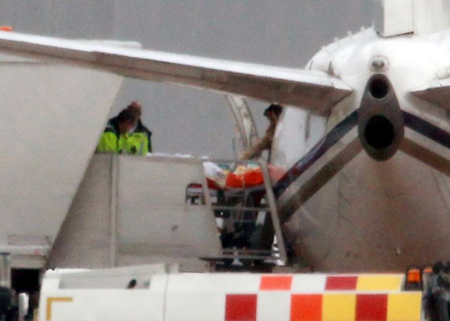 Malala Yousufzai, 14, the Pakistani schoolgirl shot in the head by Taliban gunmen, is transferred from the plane aboard a stretcher as she arrives at Birmingham Airport, England, Monday October 15, 20