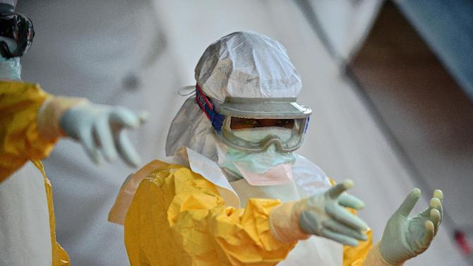 A medical worker wearing protective clothing works at an Ebola treatment facility in Kailahun, Sierra Leone, on August 15, 2014