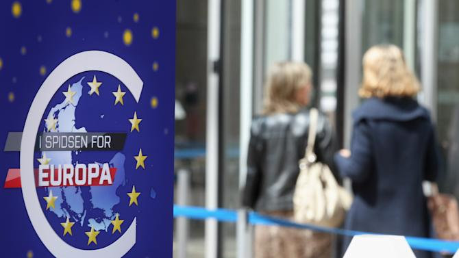 A euro logo is seen that reads in Danish: 'The head of the EU', referring to the Danish EU presidency, at the European Council building in Brussels, Tuesday, May 22, 2012. At Wednesday's informal meeting of the EU's 27 leaders in Brussels, newly elected French President Francois Hollande is expected to push for so-called eurobonds, which can be used to fund investments or boost banks' capital reserves. (AP Photo/Yves Logghe)